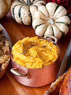 New York, NY  Chef Tom Colicchio prepares a Thanksgiving meal, including Sweet Potatoes, at his restaurant Kraft.