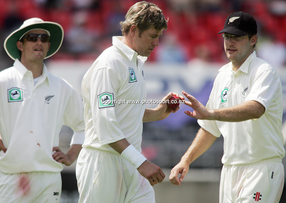 Daniel Vettori hands Jacob Oram the ball on day one of the first cricket test match between the New Zealand Black Caps and Sri Lanka at Jade Stadium, Christchurch, New Zealand on Thursday 7 December 2006. The Black Caps bowled Sri Lanka out for 154 runs and are 85/2 at the end of play on day one. Photo: Hannah Johnston/PHOTOSPORT<br /><br /><br /><br />071206