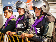 22 DECEMBER 2013 - BANGKOK, THAILAND:  Women Thai riot police officers block the home to caretaker Prime Minister Yingluck Shinawatra. Hundreds of thousands of Thais gathered in Bangkok Sunday in a series of protests against the caretaker government of Yingluck Shinawatra. The protests are a continuation of protests that started in early November and have caused the dissolution of the Pheu Thai led government of Yingluck Shinawatra. Protestors congregated at home of Yingluck and launched a series of motorcades that effectively gridlocked the city. Yingluck was not home when protestors picketed her home.    PHOTO BY JACK KURTZ