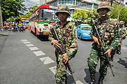 23 MAY 2014 - BANGKOK, THAILAND: Thai soldiers on a foot patrol in Bangkok Friday morning. The Thai military seized power in a coup Thursday evening. They suspended the constitution and ended civilian rule. This is the 2nd coup in Thailand since 2006 and at least the 12th since 1932. The army has ordered both anti-government protestors in Bangkok and pro-government protestors in the suburbs to go home and arrested leaders of both groups.    PHOTO BY JACK KURTZ