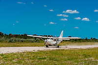 Aircraft landing at airstrip at Nxai Pan Camp, Nxai Pan National Park, Botswana.