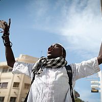 "A senegales protester screams this god name on February 19, 2012 during clashes that erupted outside a mosque in Dakar, which demonstrators said had been ""profaned"" when it was hit by tear gas grenades thrown by a police officer on February 17. Senegalese riot police fired volleys of tear gas and rubber bullets at stone-throwing demonstrators after prayers at a mosque in the Senegalese capital on February 19.. ©Sylvain Cherkaoui"