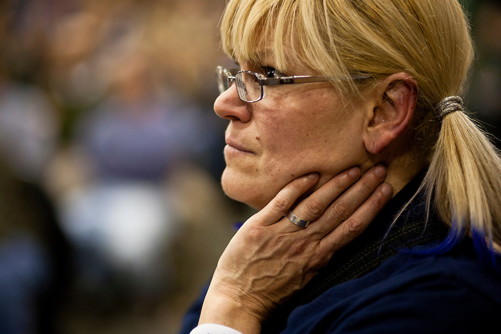 A woman listens as Republican presidential candidate Ron Paul speaks at a Salute to Veterans Rally on Wednesday, December 28, 2011 in Des Moines, IA.