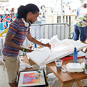 WASHINGTON, DC - August 11th, 2012 -  Howard University student Taylor Hill paints on canvas in the Fuze Tent at the Trillectro Festival at the Half Street Fairgrounds in Washington, D.C. Many local artists were on hand to create and sell original artwork during the festival.(Photo by Kyle Gustafson/For The Washington Post)