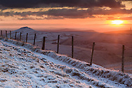 Looking back towards Hollins Parkhouse and Chrome Hills from track to Errwood (near Cat & Fiddle PH). Winter view, golden sunset and fence