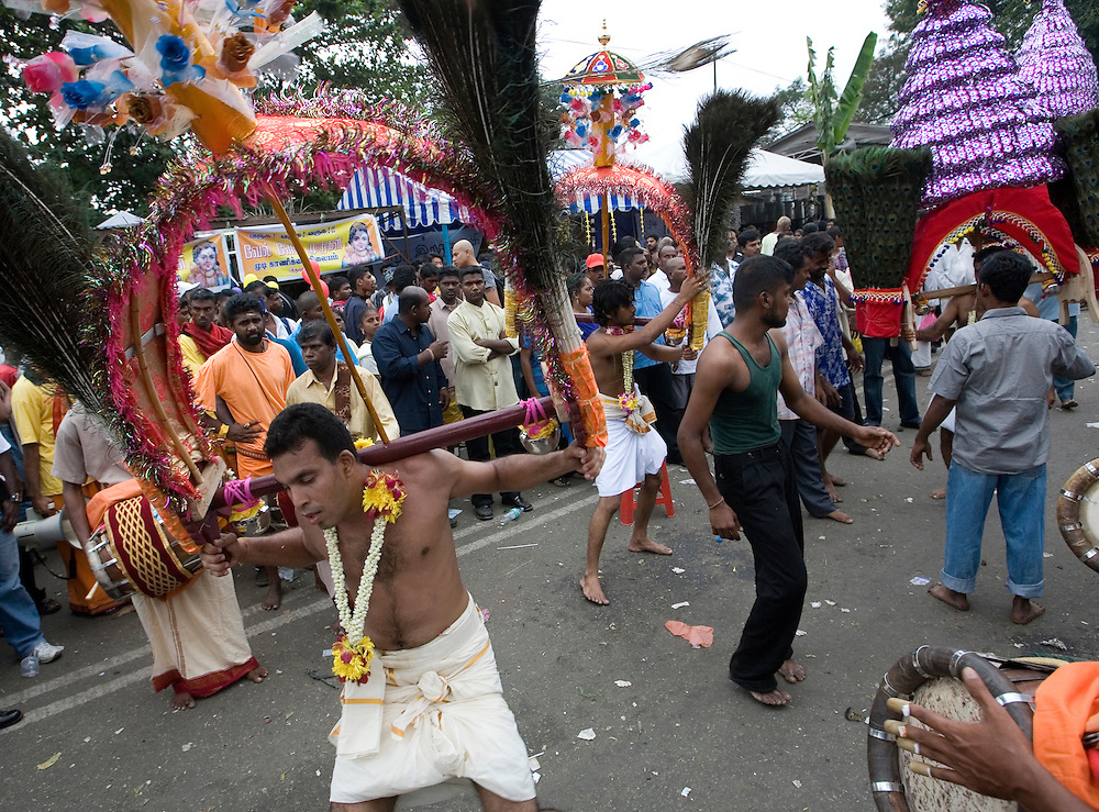 """Hindu devotees dance along their way to the sacred Batu Caves temple during the Thaipusam festival in Kuala Lumpur, Malaysia. Hindu devotees celebrate Thaipusam festival in honour of the Lord Murugan (also known as Lord Subramaniam). Thousands of Hindu devotees carried the milk pots and """"kavadi"""" (a gaily decorated wooden or metal frame) walk barefoot up the temple's 272 steps to undergo penance in fulfilling vows made to Lord Murugan for answering their prayers."""