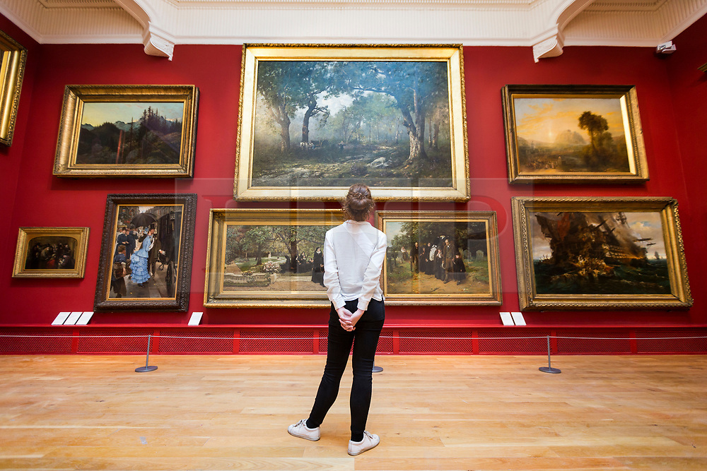 © Licensed to London News Pictures. 12/10/2017. Leeds UK. Phoebe Moore looks at the re-hung painting's by artist's such as John N Rhodes & Elizabeth Butler in the Ziff gallery at Leeds Art Gallery that is reopening tomorrow (friday 13th Oct) after an 18month renovation costing £4.5M  with new acquisitions & rehanging of the extensive collection. Founded in 1888, Leeds Art Gallery has designated collection of 19th & 20th century British painting & sculpture widely considered to be the best outside the national collections. Photo credit: Andrew McCaren/LNP