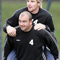 St Johnstone Training....30.08.04<br />New signing Kevin Fotheringham gives a piggy back to Ryan Stevenson<br />see story by Gordon Bannerman Tel: 01738 553978 or 07729 865788<br />Picture by Graeme Hart.<br />Copyright Perthshire Picture Agency<br />Tel: 01738 623350  Mobile: 07990 594431