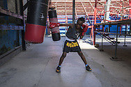 Hector, 10 years old trains at Gimnasio de Boxeo Rafael Trejo- Even his father&rsquo;s name is Hector also and it was a well-known Olympic Champion.<br /> <br /> The Cuban boxing has a centennial long prestigious history written by exceptional champions, artists of the ring, whose legendary exploits , continue to live in the stories of fans. In 1962 Cuba had abolished professionalism in sports. Two years ago, driven by economic interests and attempt to stop the bleeding of athletes on the run from the island, sports authorities have announced participation in world boxing championship, the World Series of Boxing (WSB), which are not however a professional circuit because they remain part of the Olympic boxing. Thanks to a law passed a few years ago, with new economic conditions for the Cuban athletes, now, in addition to the contributions they receive from the state, the Cuban boxers will earn from their sport, 80% of the proceeds from participation in international sporting events.<br /> Meanwhile two years ago, in a small corner of Centro Habana, two blocks from the Capitolio and the square of big international hotels such as Telegraph and England, between the peeling walls of two buildings, in the space left by a collapsed building,<br /> thanks also the association Italian Malaika (Angel in swahili), there is a gymnasium de Boxeo, a gym of wooden planks recycled for the children of Centro Habana. In this neighborhood gym the talent and enthusiasm of dozens of children between 7 and<br /> 20 years is concentrated: Los Ninos de Cuba. Every day from 5 pm until late at night they chasing their dreams of success, with ethics, rigor and commitment, The facilities are not enough for everyone. Gloves and shoes alternate in the hands and feet of small boxeadores, which in turn &ldquo;peleano&rdquo; on the makeshift ring waiting to make the leap to the Rafael Trejo, another Boxing Gymnasium, in the heart of Havana Vieja, to participate in provincial and then national cham