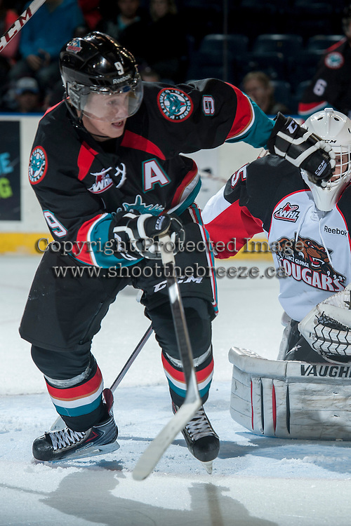 KELOWNA, CANADA - OCTOBER 19: Zach Franko #9 of the Kelowna Rockets skates on the ice against the Prince George Cougars on October 19, 2013 at Prospera Place in Kelowna, British Columbia, Canada.   (Photo by Marissa Baecker/Shoot the Breeze)  ***  Local Caption  ***