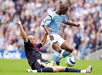 Photo: Daniel Hambury.<br /> Manchester City v West Bromich Albion. Barclaycard Premiership. 13/08/2005.<br /> Manchester City's Breadley Wright-Phillips is tackled by West Brom's Neil Clement.