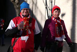 Arsenal fans arriving at the ground before the game