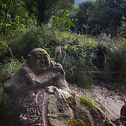 An old stone carving on the path from the Po Lin Monastery near Ngong Ping village on Lantau.