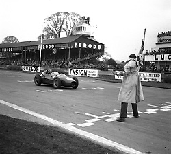 MIKE HAWTHORNE in a Ferrari racing at Goodwood Race track, Sussex in 1958.