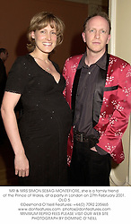MR & MRS SIMON SEBAG-MONTEFIORE, she is a family friend of the Prince of Wales, at a party in London on 27th February 2001.OLO 5