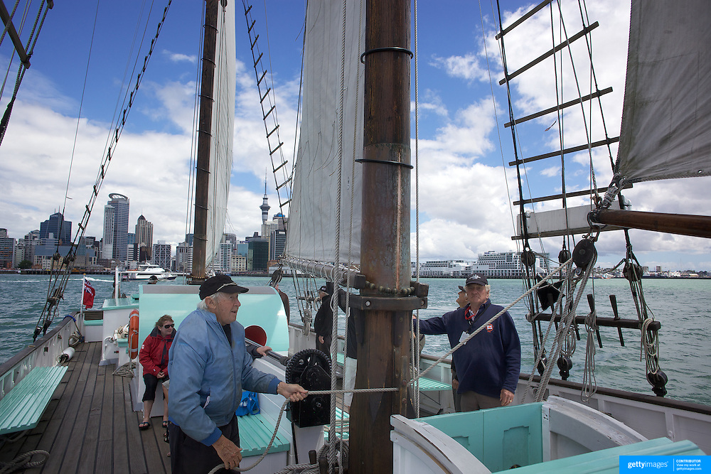 Crewmen sailing the Historic Scow which sails as a tourist vessel from the NZ Maritime Museum, on Auckland Harbour. Auckland, New Zealand, 3rd November 2010. Photo Tim Clayton