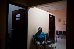 Nolvia Cruz waits to be seen at an HIV/AIDS health clinic on January 25, 2013  in La Ceiba, Honduras. Nolvia is public with her diagnosis, though there are many people who are afraid to go to the clinic, for fear that someone they know will see them and gossip about their HIV status.(David Rochkind/ Pulitzer Center)