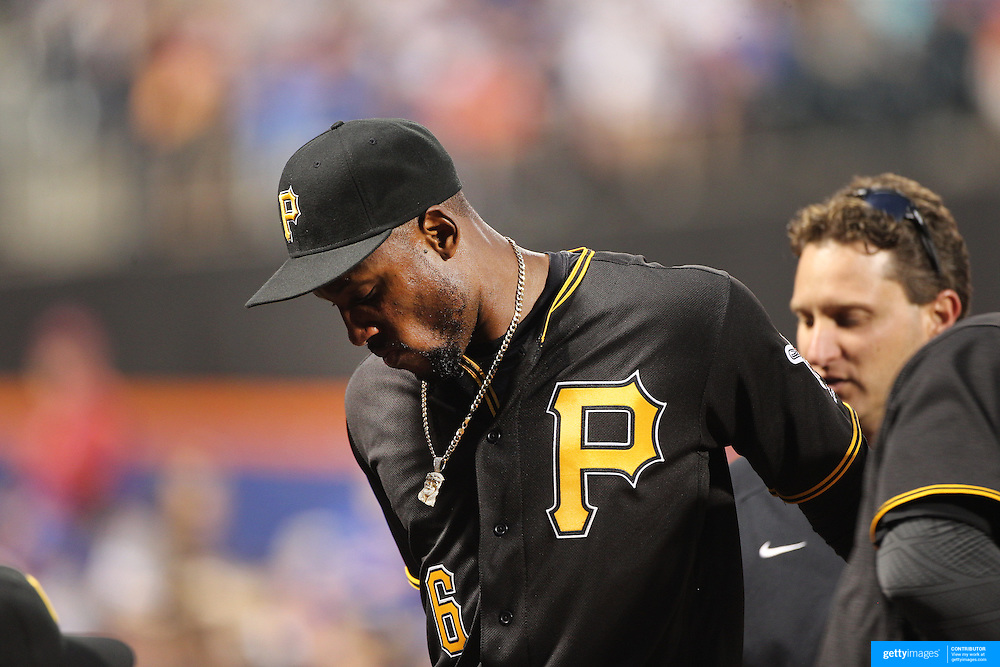 NEW YORK, NEW YORK - June 15: Starling Marte #6 of the Pittsburgh Pirates leaves the game after getting hit in the face while attempting to catch a ball in the outfield  during the Pittsburgh Pirates Vs New York Mets regular season MLB game at Citi Field on June 15, 2016 in New York City. (Photo by Tim Clayton/Corbis via Getty Images)