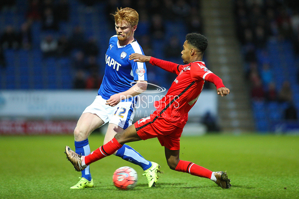 Walsall FC defender Rico Henry wins the ball from Chesterfield FC defender Liam O'Neil during the The FA Cup match between Chesterfield and Walsall at the Proact stadium, Chesterfield, England on 5 December 2015. Photo by Aaron Lupton.