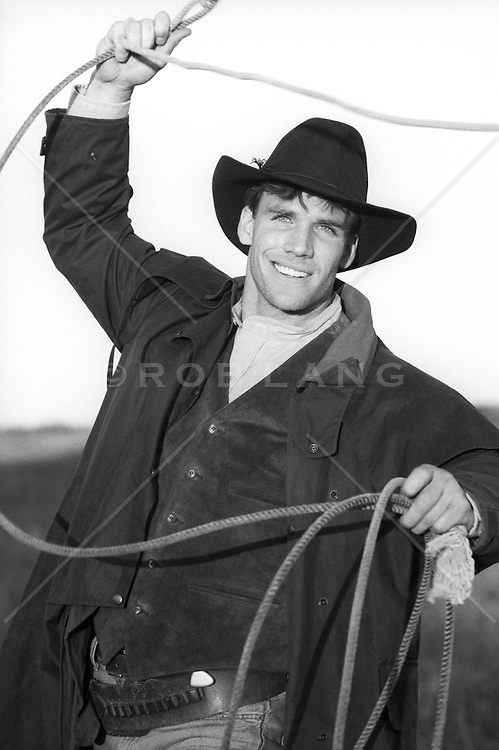 cowboy with a lasso outdoors