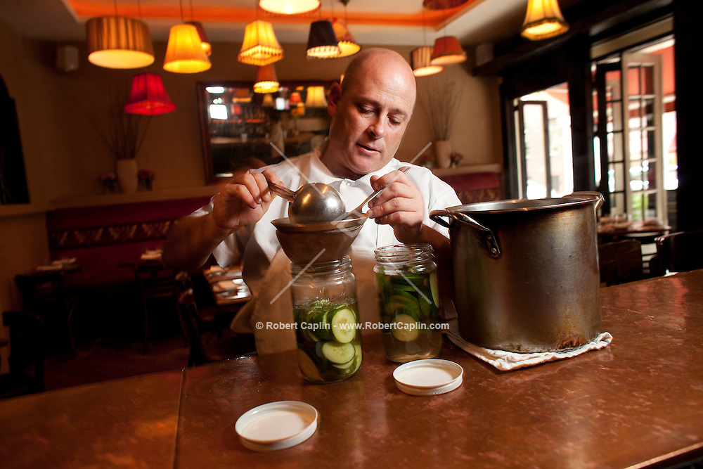 John Eden, owner of Shorty's 32, with his famous pickles that garnish the chef's coveted  hamburger entree in New York, NY on Friday, June 19, 2009.