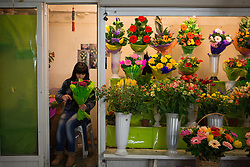 Crimea one day before the referendum. A flower seller prepare a bouquet in an underground shop in downtown Simferopol, . Saturday, 15th March 2014. Picture by Daniel Leal-Olivas / i-Images