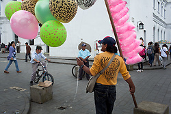 Jan. 17, 2012 - Popayan, Colombia. A man sells ballons and sugar cane. © Nicolas Axelrod / Ruom