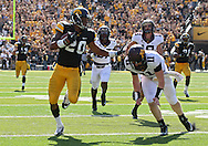 September 29 2012: Iowa Hawkeyes linebacker Christian Kirksey (20) holds off Minnesota Golden Gophers quarterback Max Shortell (11) while returning an interception 68 yards for a touchdown during the fourth quarter of the NCAA football game between the Minnesota Golden Gophers and the Iowa Hawkeyes at Kinnick Stadium in Iowa City, Iowa on Saturday September 29, 2012. Iowa defeated Minnesota 31-13 to claim the Floyd of Rosedale Trophy.