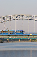 blue tram seen crossing pilsudski bridge from krakow's kazimierz district to podgorze in sunshine in september 2005