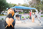 Ray Schulz visits Black Bear Diner in Milpitas, Calif. to demonstrate his chainsaw carving of the Black Bear wooden sculptures on July 10, 2012.  Schulz has been sculpting bears and other figures with a chainsaw for over 15 years.  Photo by Stan Olszewski/SOSKIphoto.