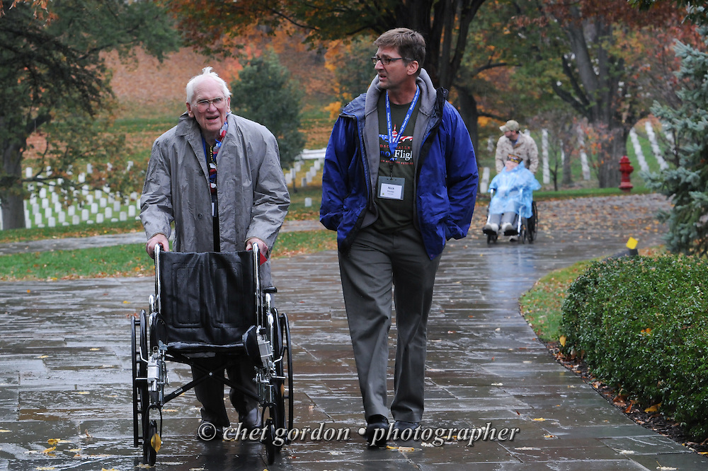 WWII Veterans and their escorts onboard the Hudson Valley Honor Flight #10 at Arlington National Cemetery in Arlington, VA on Saturday, November 7, 2015. Sixty-four veterans from the Westchester County (NY) area toured the WWII and Marine Corps War Memorials, as well as Arlington National Cemetery. Hudson Valley Honor Flight is a chapter of the Honor Flight Network, which provides free flights for WWII Veterans and tours of the WWII Memorial constructed in their honor, and other sites in the nation's capital.  © Chet Gordon / Hudson Valley Honor Flight