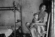© Jean-Franc?ois Leblanc / Agence Stock Photo.Une femme et son be?be? regardant par la oorte de sa demeure. .