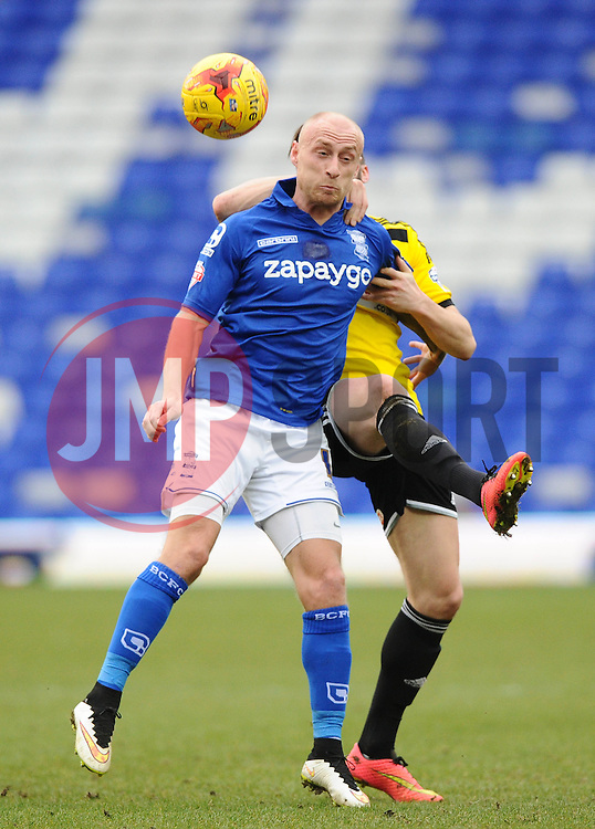 Birmingham City's David Cotterill battles for the ball with Brentford's Stuart Dallas  - Photo mandatory by-line: Joe Meredith/JMP - Mobile: 07966 386802 - 28/02/2015 - SPORT - Football - Birmingham - ST Andrews Stadium - Birmingham City v Brentford - Sky Bet Championship