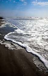 Surf landing on the beach, Spanish Grant development, West Beach, Galveston Island, Texas Gulf Coast.