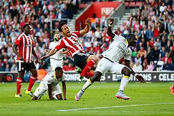 Maya Yoshida of Southampton clashes with Kelvin Leerdam of Vitesse Arnhem - Mandatory by-line: Jason Brown/JMP - Mobile 07966386802 - 31/07/2015 - SPORT - FOOTBALL - Southampton, St Mary's Stadium - Southampton v Vitesse Arnhem - Europa League
