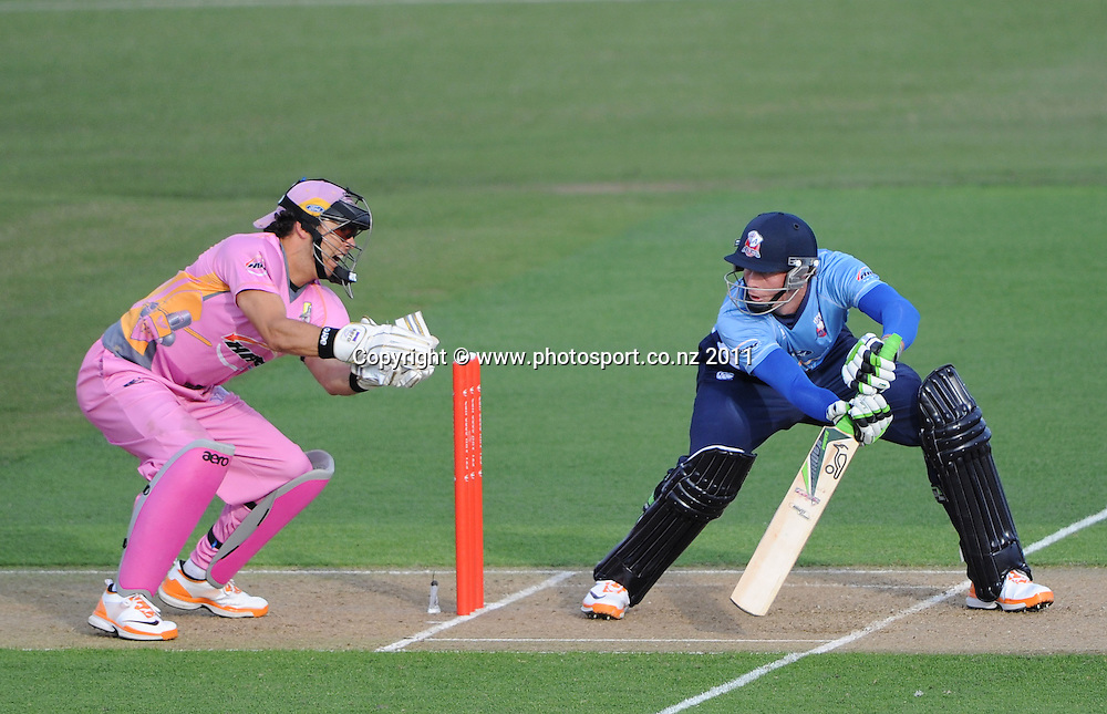 Auckland batsman Martin Guptill cuts during the HRV Twenty20 Cricket match between the Auckland Aces and Northern Knights at Colin Maiden Oval in Auckland on Monday 26 December 2011. Photo: Andrew Cornaga/Photosport.co.nz
