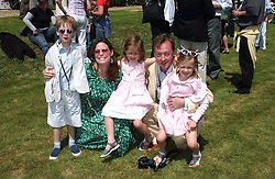 "Editor of Tatler GEORDIE GRIEG and his wife KATHERINE with their twin daughters, OCTAVIA and MONICA and their son JASPER at a luncheon hosted by Cartier at the 2005 Goodwood Festival of Speed on 26th June 2005.  Cartier sponsored the ""Style Et Luxe' for vintage cars on the final day of this annual event at Goodwood House, West Sussex. <br />