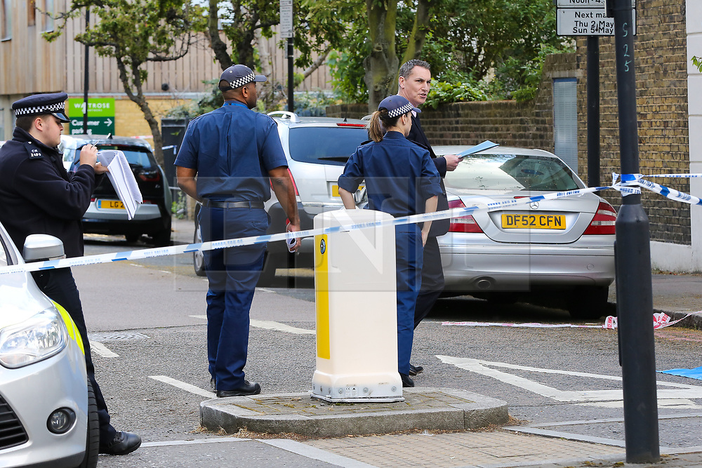 © Licensed to London News Pictures. 12/05/2019. London, UK. Forensics officers arrives on Tollington Road, at the junction of Annette Road, Islington in north London as Met police launch an investigation into the death of a man who was found in a wheelie bin behind a Waitrose store shortly before 4pm on Saturday 11 May 2019. Photo credit: Dinendra Haria/LNP