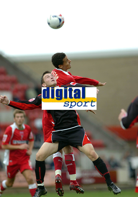 Photo: Kevin Poolman.<br />Swindon Town v Lincoln City. Coca Cola League 2. 28/10/2006. Swindon's Curtis Weston and Lee Frecklington of Lincoln (front) both go up for the ball.