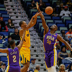 Feb 5, 2018; New Orleans, LA, USA; Utah Jazz guard Rodney Hood (5) is defended by New Orleans Pelicans center Emeka Okafor (50) and guard Ian Clark (2) during the first quarter at the Smoothie King Center. Mandatory Credit: Derick E. Hingle-USA TODAY Sports