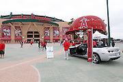 ANAHEIM, CA - MAY 22:  A large metal baseball cap displays the team logo next to an car promotional stand outside the stadium at the game between the Atlanta Braves and the Los Angeles Angels of Anaheim on Sunday, May 22, 2011 at Angel Stadium in Anaheim, California. The Angels won the game 4-1. (Photo by Paul Spinelli/MLB Photos via Getty Images)
