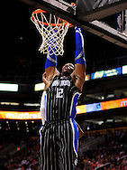 Mar. 13, 2011; Phoenix, AZ, USA; Orlando Magic center Dwight Howard (12) dunks the ball against the Phoenix Suns at the US Airways Center. The Magic defeated the Suns 111-88. Mandatory Credit: Jennifer Stewart-US PRESSWIRE