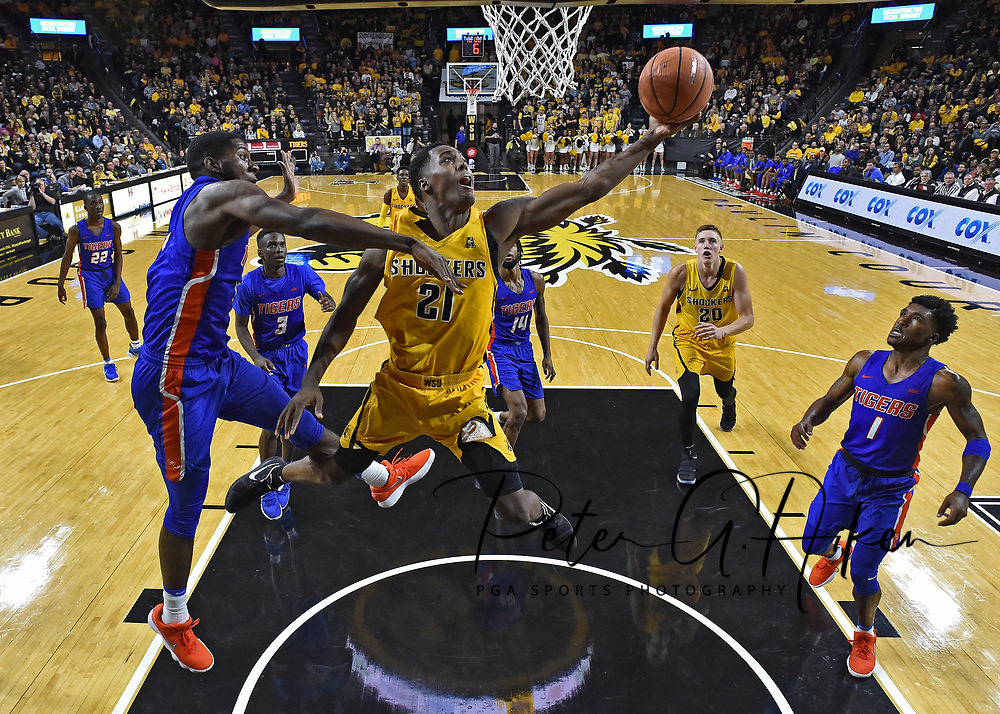 Wichita State Shockers forward Darral Willis Jr. (21) drives in for a basket against Savannah State Tigers center Maricus Glenn (10) during the second half at Charles Koch Arena.