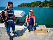 "13 FEBRUARY 2019 - SIHANOUKVILLE, CAMBODIA: Chinese tourists in Sihanoukville wait for a high speed ferry to take them to a nearby island. There are about 80 Chinese casinos and resort hotels open in Sihanoukville and dozens more under construction. The casinos are changing the city, once a sleepy port on Southeast Asia's ""backpacker trail"" into a booming city. The change is coming with a cost though. Many Cambodian residents of Sihanoukville  have lost their homes to make way for the casinos and the jobs are going to Chinese workers, brought in to build casinos and work in the casinos.      PHOTO BY JACK KURTZ"