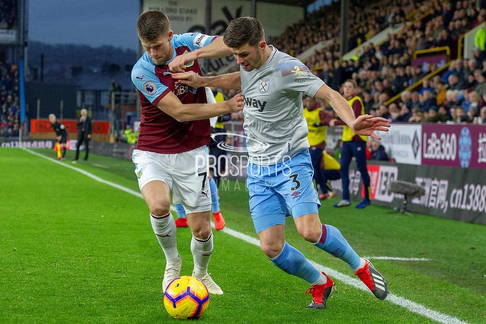 Burnley midfielder Johann Gudmundsson (7) battles with West Ham United defender Aaron Cresswell (3) during the Premier League match between Burnley and West Ham United at Turf Moor, Burnley, England on 30 December 2018.