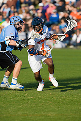 Virginia midfielder Shamel Bratton (1) runs past Johns Hopkins midfielder Andrew Miller (3).  The #2 ranked Virginia Cavaliers defeated the #6 ranked Johns Hopkins Blue Jays 13-12 in overtime at the University of Virginia's Klockner Stadium in Charlottesville, VA on March 22, 2008.  The loss, in front of a record UVA crowd of 7,500, was the third consecutive overtime defeat for Hopkins, the defending national champions.