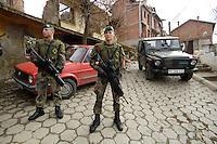 05 DEC 2005, SERBIA/KOSOVO/PRIZREN:<br /> Bundeswehrsoldaten, bewaffnet mit dem Gewehr G11 und ein Mercedes Gelaendewagen Typ Wolf der Bundewehr, Deutsches Kontingent der KFOR Schutztruppe, Inenstadt von Prizren<br /> IMAGE: 20051205-01-049<br /> KEYWORDS: Soldat