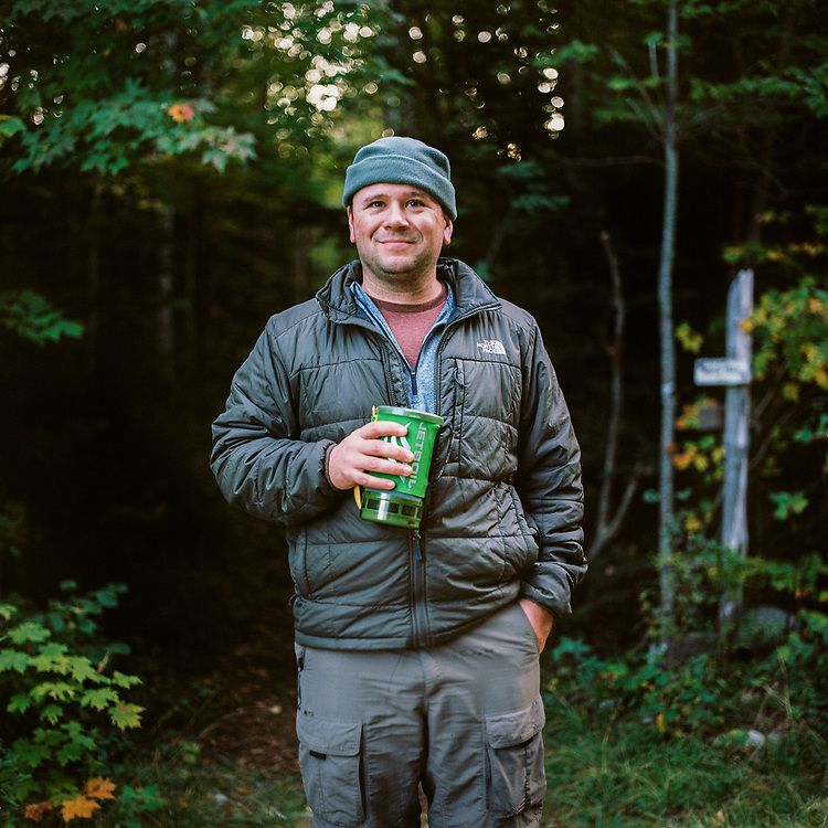 Andrew drinking his coffee at the trailhead of the Mahoosuc Notch out of his Jetboil