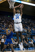 UCLA Bruins forward Jalen Hill (24) goes in for a dunk with San Jose State Spartans guard Seneca Knight (13) defending during an NCAA college basketball game, Sunday, Dec. 1, 2019, in Los Angeles. UCLA defeated San Jose State 93-64. (Jon Endow/Image of Sport)