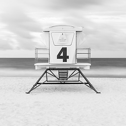 Pensacola Beach lifeguard tower four photo on Casino Beach in black and white. Pensacola Beach Florida is a coastal city on Santa Rosa Island in the Southeastern United States of America. Copyright ⓒ 2018 Paul Velgos with All Rights Reserved.